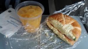 Coach breakfast -- Egg salad sandwich and a screwdriver