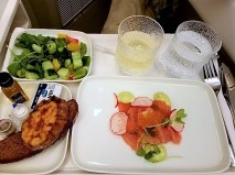 Smoked salmon appetizer, tossed salad and warm bread.