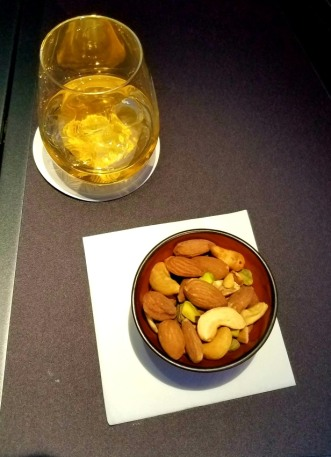 Cocktail and nuts in a bowl rather than packaged