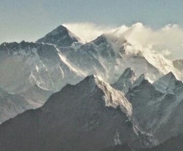 Everest upper left. Lhotse's summit plume right.