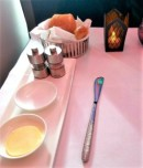 Full size tablecloth, candle and assorted breads