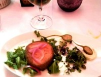 Smoked salmon ballotine with Italian cream cheese, capers, pickled onions, and arugula.