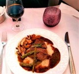 Peppercorn beef, mashed potatoes, chanterelle mushrooms, asparagus, and torpedo shallots and Chateau Vieux Maillet Bordeaux.